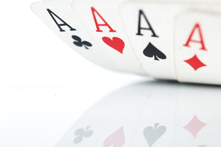 Four of a kind aces macro shot on white background