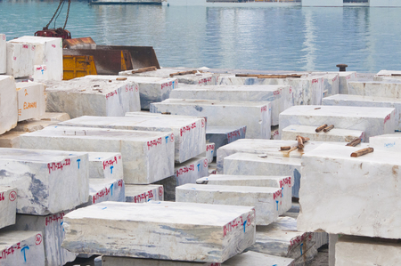 Carrara's white marble stones stocked in the harbor and ready to be shipped
