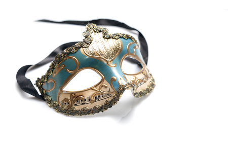 Blue venetian mask with musical notes and gold decorations isolated on white background