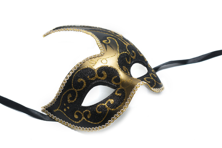 Black and gold venetian mask with swand decoration isolated