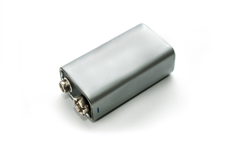 A blank silver 9v battery on white background