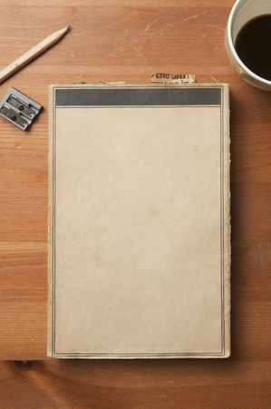 Old blank cove book with paper bookmarks on a wooden table