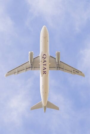 PISA, ITALY - JUNE 12, 2019 - An aircraft (Airbus A320-200) of Qatar Airways takes off from Pisa airport, photographed from below. Redakční