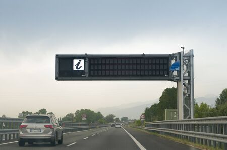 PISA , ITALY - June 10, 2019:  Electronic scoreboard for information on traffic and weather on an Italian motorway