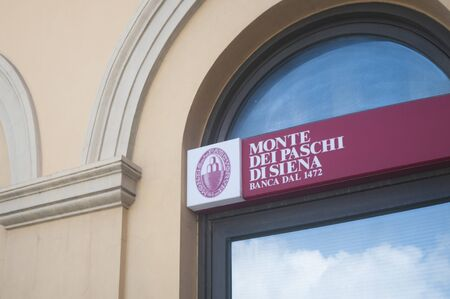 CARRARA, ITALY - JUNE 16, 2019: The sign of the Monte dei Paschi di Siena, one of the oldest banks in the world