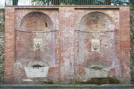 View of Carrara, Italy: the fountain of the big masks (fontana dei mascheroni) Reklamní fotografie