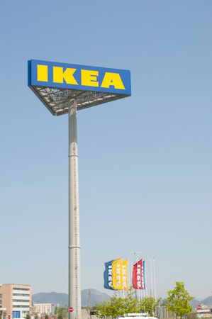PISA, IT - JUNE, 25 2019;  IKEA pole sign and flags out of the Pisas store in Italy, lot of copy space