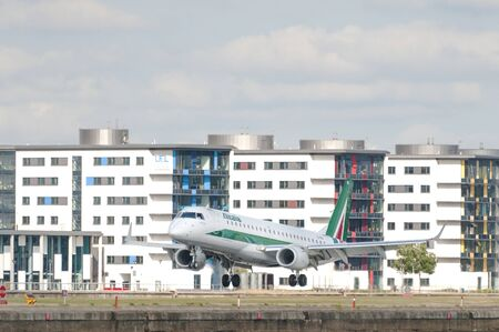 LONDON, UK - AUGUST 02, 2013: Alitalia airplane land at London City Airport, the fifth busiest airport in London.