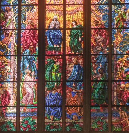 PRAGUE, CZECH REPUBLIC – OCTOBER 10, 2014: Detail of a stained glass inside the St. Vitus Cathedral