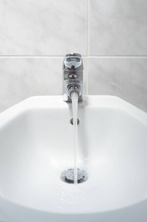 Bidet with running water front shot.The bidet was invented in France in the 1700s
