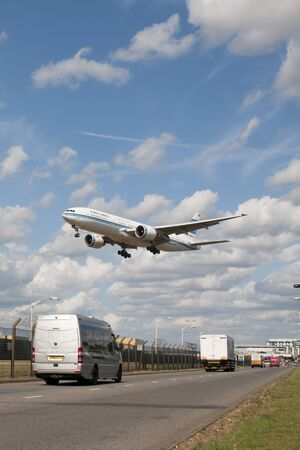 London, uk - June 29, 2019 - Kuwait Airways airplane cross Myrtle Avenue at very low altidude to land at Heathrow airport in London