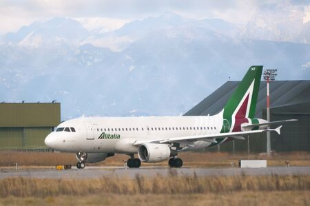 Pisa, Italy - January 15, 2017 - Alitalia Airbus taxiing on the runway before take off at Galileo Galilei airport