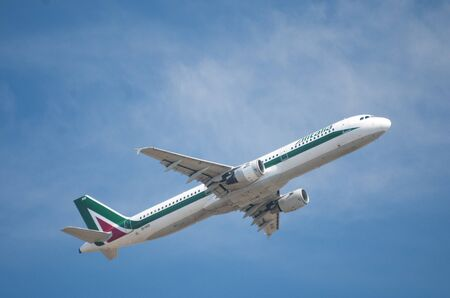 Rome, Italy - July 12, 2013 - Alitalia Airbus a321 take off from Fiumicino airport in Rome
