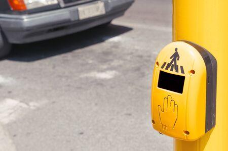 Pedestrian crosswalk button with a car on background, lot of copy space Reklamní fotografie