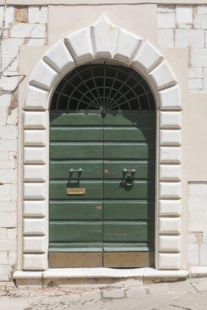 Wood door with marble portal