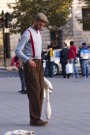 London, Uk - October 12 2009 - Street artist perform with juggling clubs in Trafalgar Square