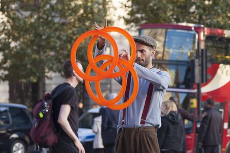 London, Uk - October 12 2009 - Street artist perform with juggling rings in Trafalgar Square