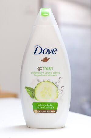 Carrara, Italy - July 21, 2019 - Bottle of Dove go fresh shower cream with the scent of green tea and cucumber, special formula for smooth and luminous soft skin