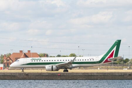 London, Uk - August 2, 2013 - Alitalia regional airplane taxiing at London City Airport after landing