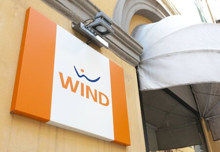 Carrara, Italy - August 4, 2019 - The sign of the Italian communication operator Wind out of a store