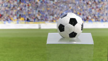 Black and white soccer ball on a plexiglas stand in a stadium before the match