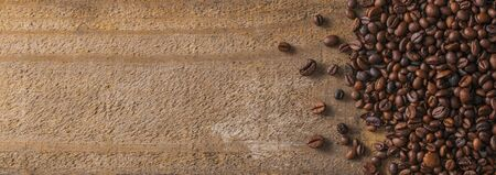 Fresh roasted coffee beans on wood background, lot of copy space