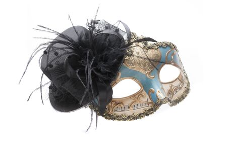 Blue venetian theatre mask with musical notes and gold decorations with a black lace hat isolated on white background Stock fotó