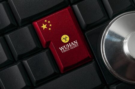 Wuhan chinese virus alert concept: a black computer keyboard with chinese flag enter key to spread an alert Standard-Bild - 138444016