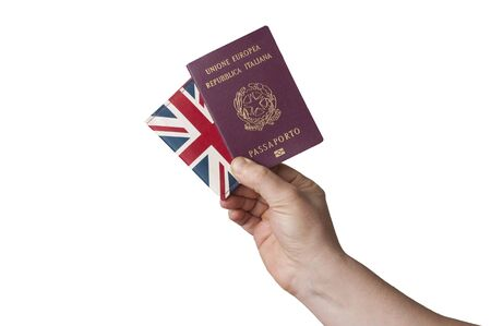 Man hold a european union italian passport and a united kingdom flag wallet on white background Stock Photo