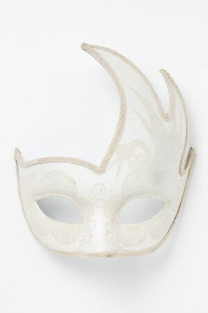 White theater carnival mask on white background, vertical shot