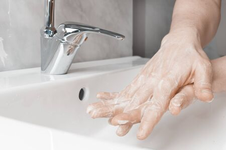 Effective handwashing techniques: between the fingers. Hand washing is very important to avoid the risk of contagion from coronavirus and bacteria.