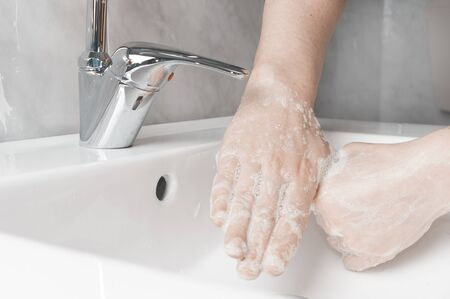 Effective handwashing techniques: rubbing each thumbs. Hand washing is very important to avoid the risk of contagion from coronavirus and bacteria.
