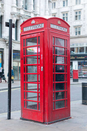 London, UK - January 26, 2011 - An iconic red telephone booth in Oxford Street, in central London