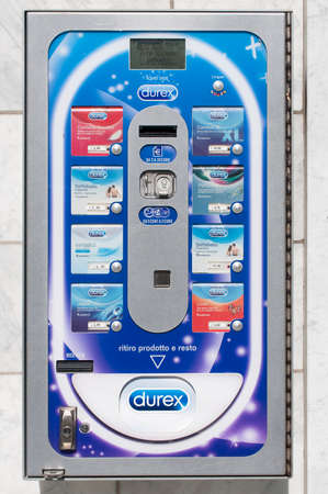 Carrara, Italy - June 14, 2020 - A Durex condom machine outside a pharmacy in Italy
