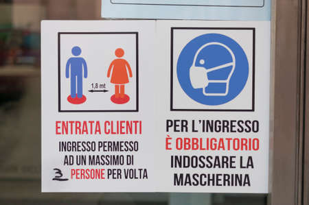 Carrara, Italy - June 14, 2020 - Covid-19 rules to access a shop in Italy