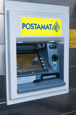 Carrara, Italy - June 15, 2020 - A Postamat cash machine (ATM machine) outiside a postal office in Italy