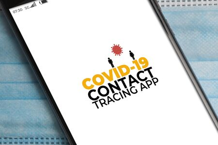 Smartphone running a Covid.19 contact tracing app over a surgical mask