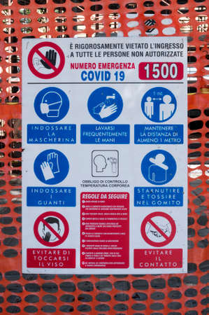 Carrara, Italy - June 17, 2020 - Covid-19 rules at the entrance of a construction site in Italy