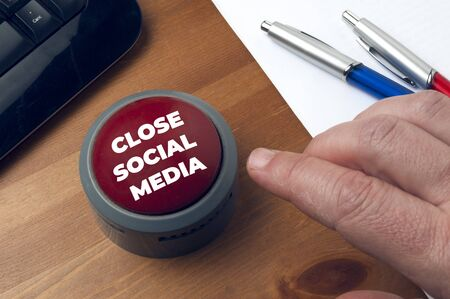 Man presses red button with the inscription close social media. The threat of shutting down social media has recently rebounded in many newspapers around the world.