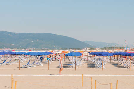 Carrara, Italy - July 15, 2020: Semi-deserted beach due to covid-19 restrictions Redactioneel