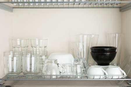 Typical Italian dinnerware cabinet with glasses and bowls for different beverages and foods Stockfoto