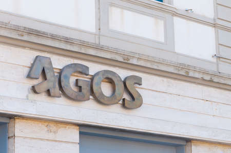 Carrara, Italy - July 10, 2020 - The metal sign of the Agos company. Agos is an Italian financial company that operates in the sector of lending to households and consumer credit.