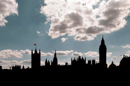Silhouette of Westminster: the house of parliament and the Big Ben over a cloudy sky in London