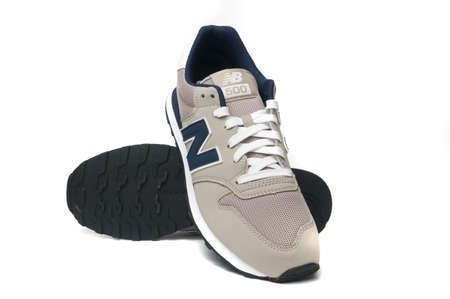 Carrara, Italy - August 15, 2020 - A pair of New Balance GM 500 TRV on white background front and sole view