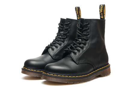 Carrara, Italy - October 07, 2020 - A pair of leather Dr. Martens Air Wair boots on white background