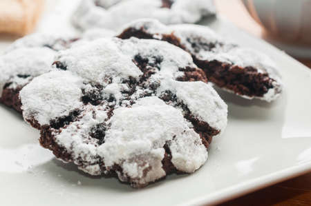 Double chocolate crinkle cookies on white plate