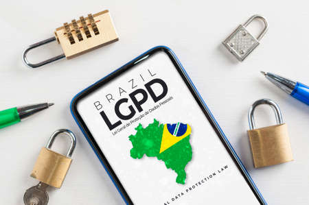LGPD (brazilian data protection law) concept: smartphone sorrounded by padlocks with an imaginary page showing a link to read the Brazilian data protection law (Lei Geral de Proteção de Dados Pessoais)