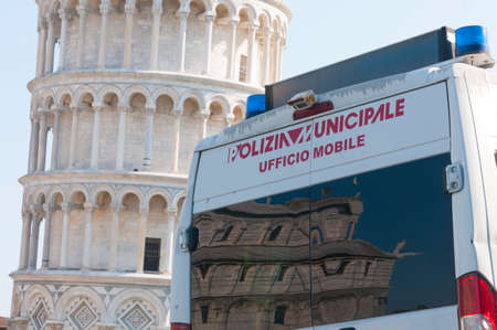 Pisa, Italy - March 10, 2021 - Vehicle of the municipal police of pisa guards the square with the leaning tower of pisa during the lockdown