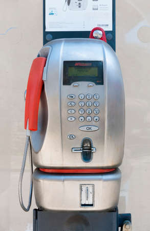 Pisa, Italy - March 19, 2021 - Telecom Italia public phone booth 에디토리얼