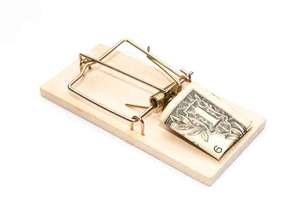 Mousetrap with dollar bill as a bait 스톡 콘텐츠